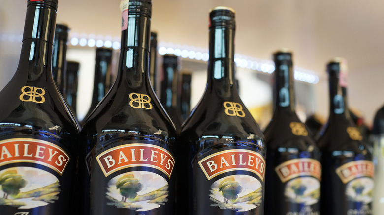 Rows of  Baileys bottles