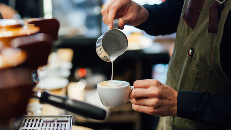 Barista making latte foam art