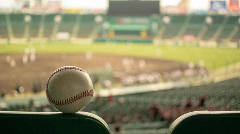 Ball on baseball seat in stadium