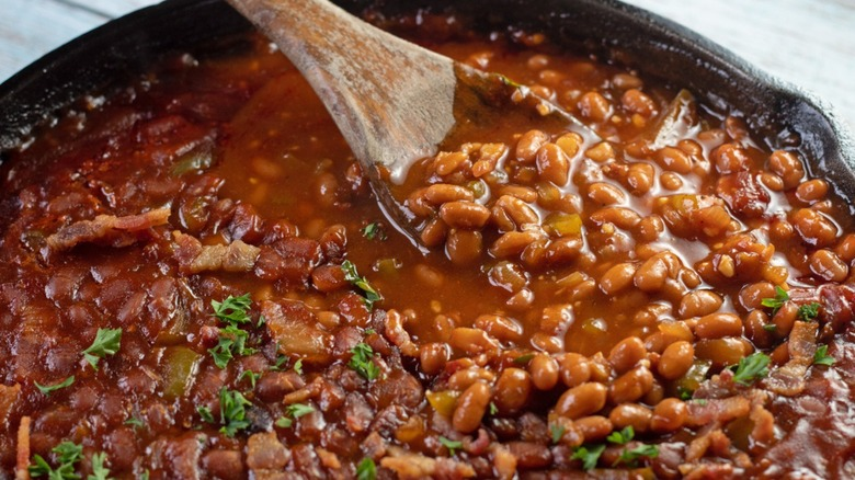 baked beans with wooden spoon