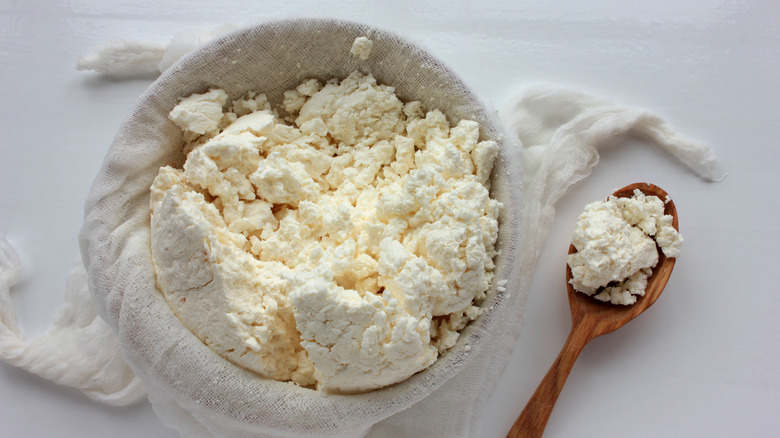 Fresh cheese in cheesecloth with spoon