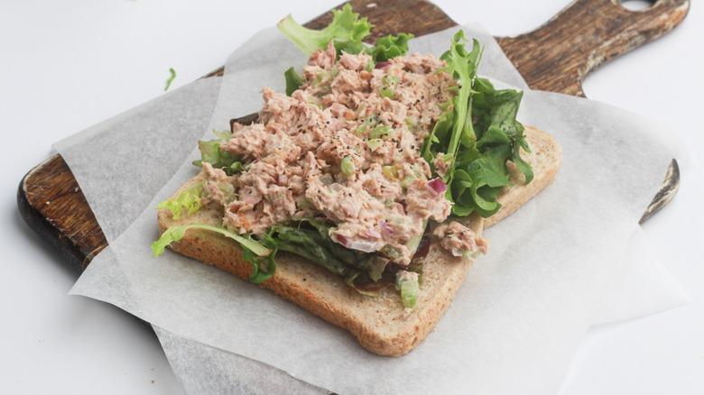 tuna sandwich on cutting board