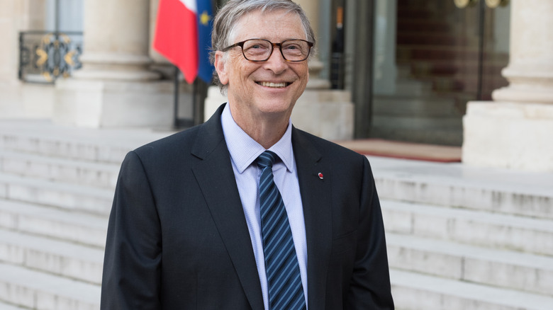 Bill Gates with flags in background
