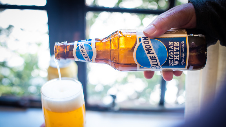 Blue Moon being poured in a glass