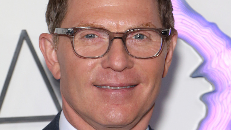 Bobby Flay smiling in glasses