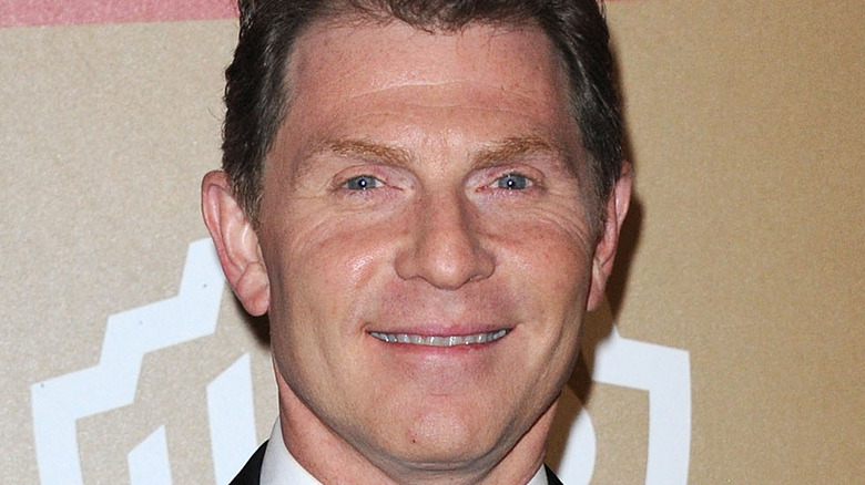 Bobby Flay smiling at event