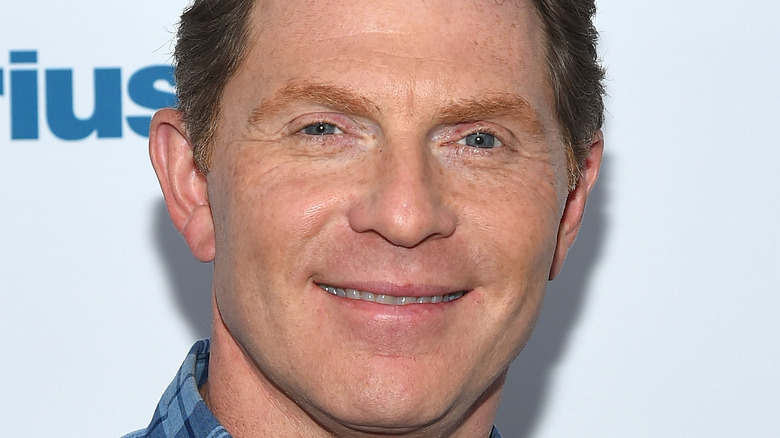 Bobby Flay smiling on red carpet