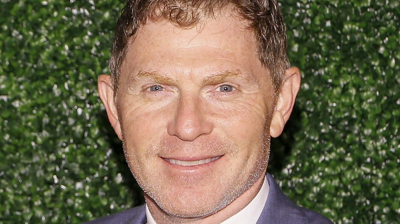 Bobby Flay smiling against green backdrop