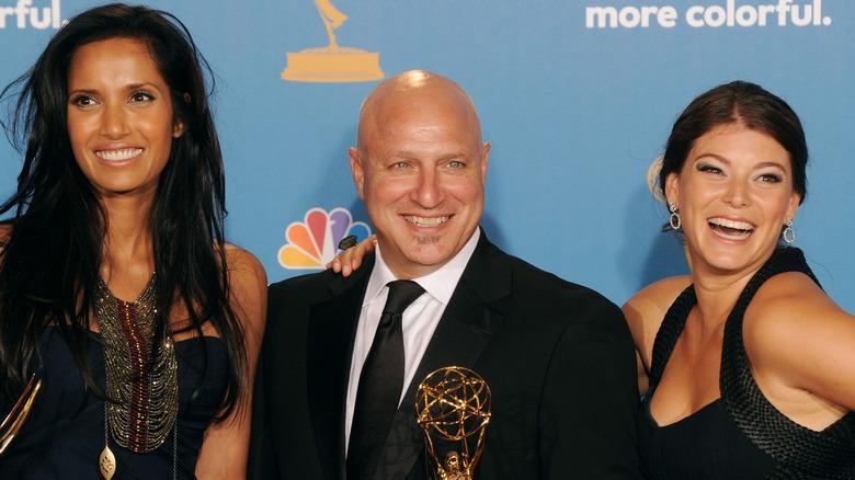 Padma Lakshmi, Tom Colicchio, and Gail Simmons smile in black