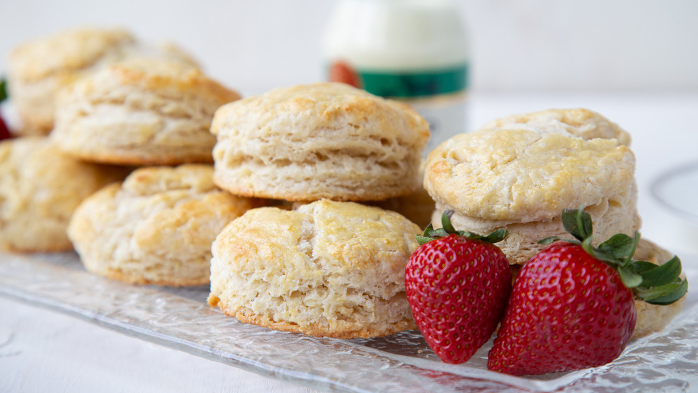 british scones on glass plate with fresh strawberries