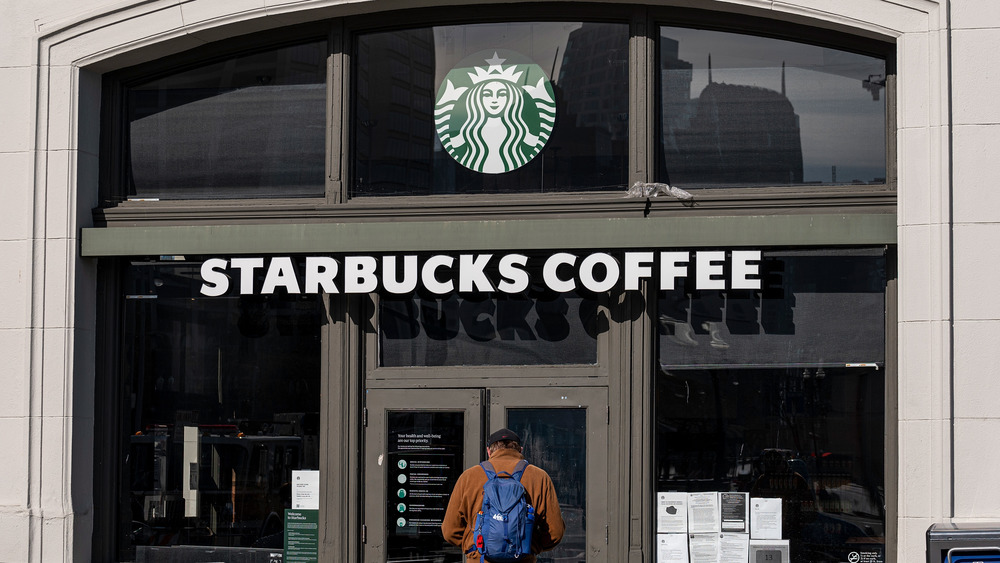 Person entering Starbucks coffee shop