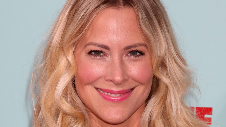 Brittany Daniel smiling on red carpet