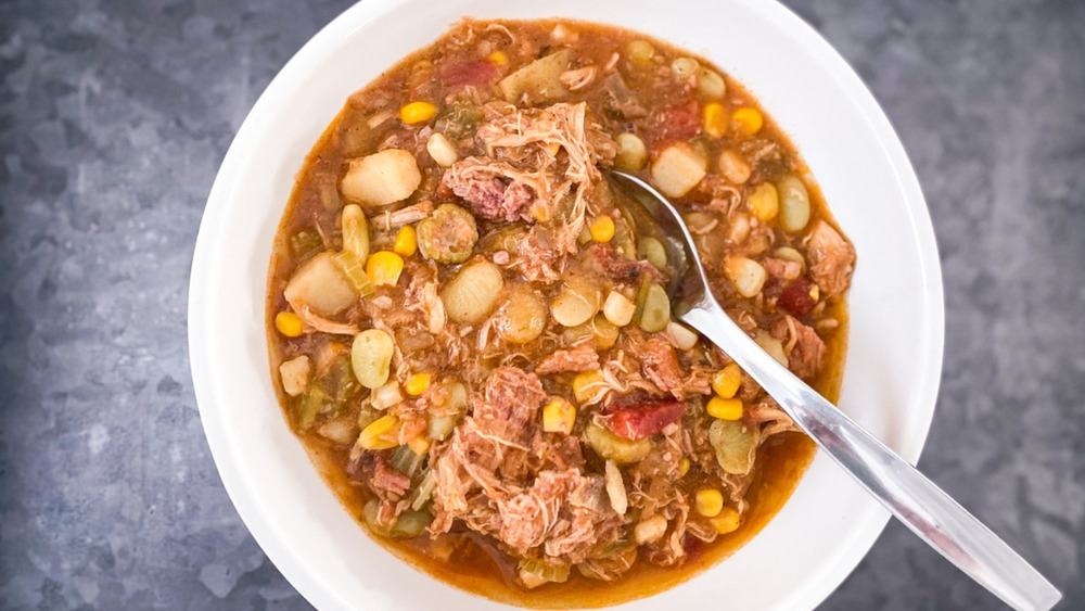 Bowl of Brunswick stew with spoon