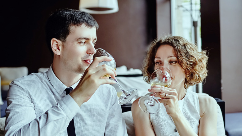 Couple sipping wine on date