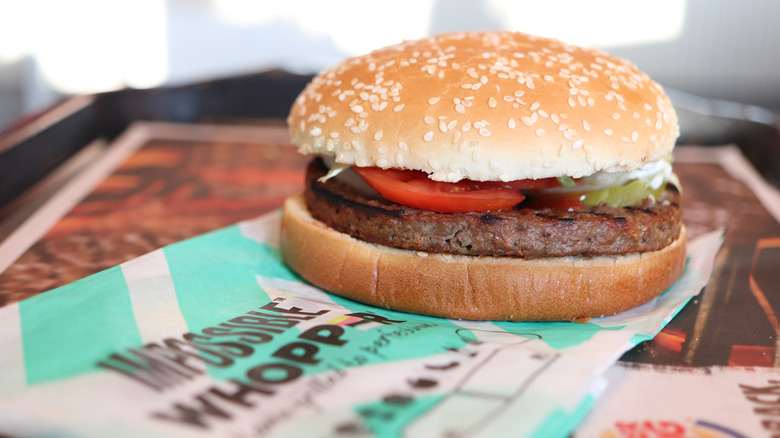 Impossible Whopper on blue striped paper wrapping