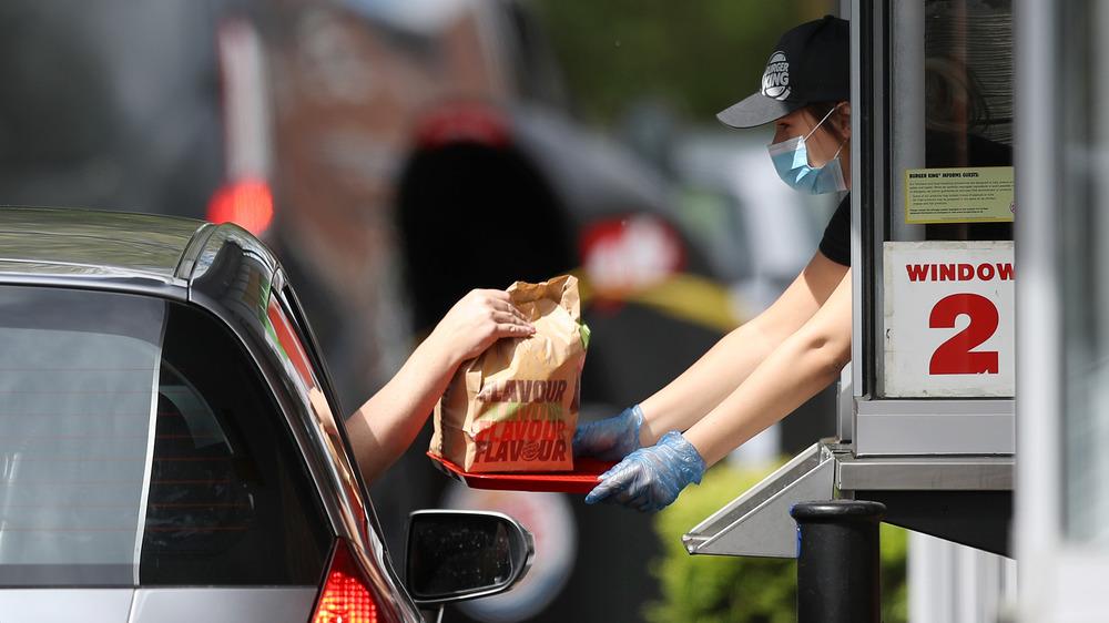 Woman working at Burger King drive-thru