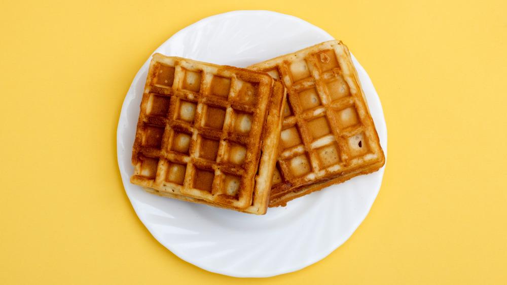 crisp waffles on a white plate