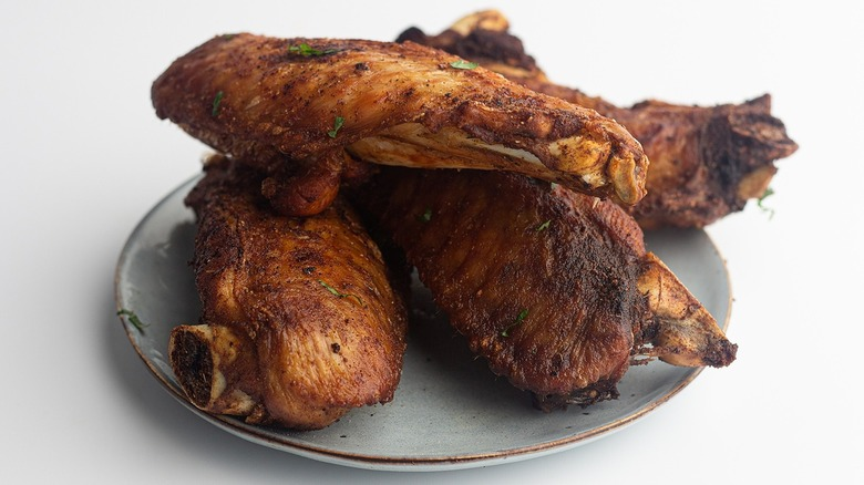 Fried turkey wings sitting on a plate