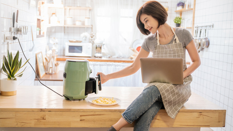 Woman with air fryer