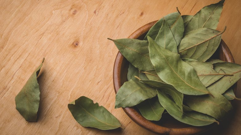 Dried bay leaves in a bowl