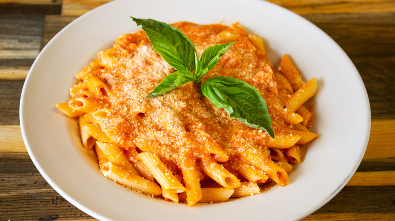 pasta with sauce in white bowl