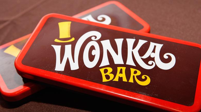 Plastic Wonka chocolate bars on brown wood