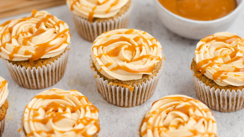 Banoffee cupcakes with caramel syrup drizzled on top