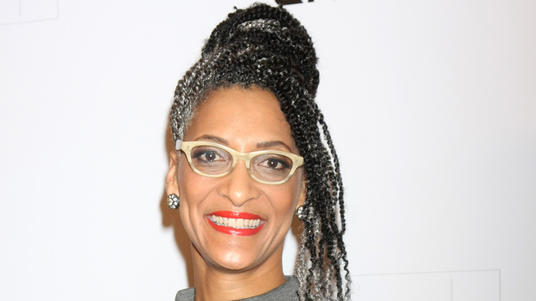Carla Hall with glasses and red lipstick