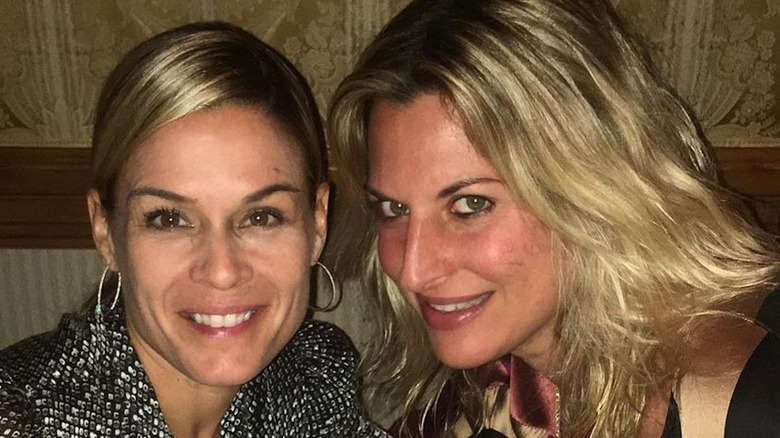 Cat Cora and Nicole Ehrlich in a booth