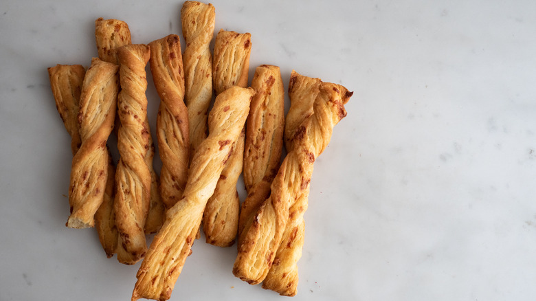 The classic Italian-inspired breadsticks on white surface