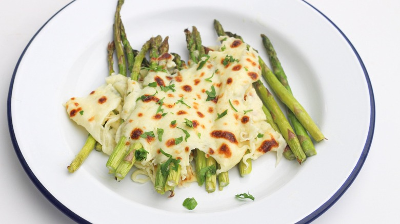 Cheese-topped asparagus on plate