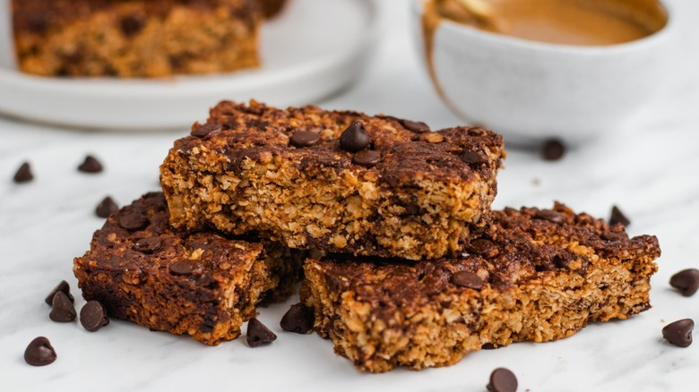 Peanut butter granola bars with bowl of something