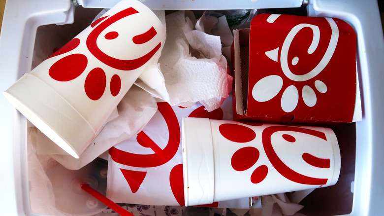 Chick-fil-A containers in trash bin