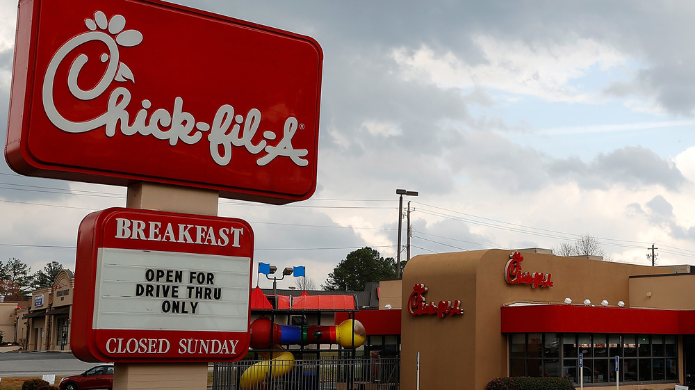 """Chick-fil-A with """"open for drive thru only"""" on readerboard"""