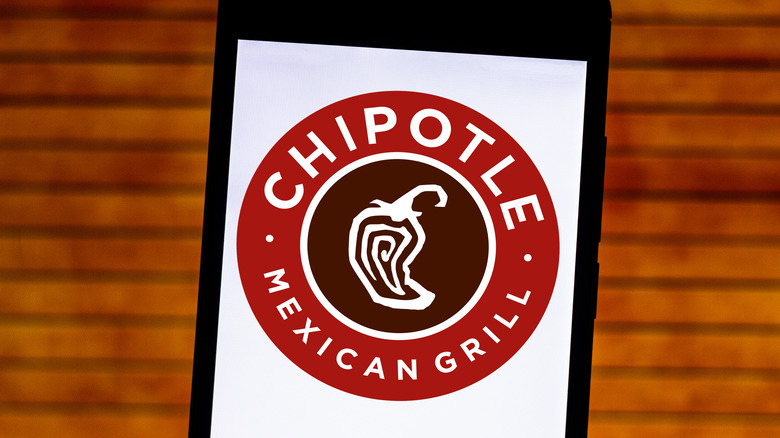 The Chipotle logo on a phone
