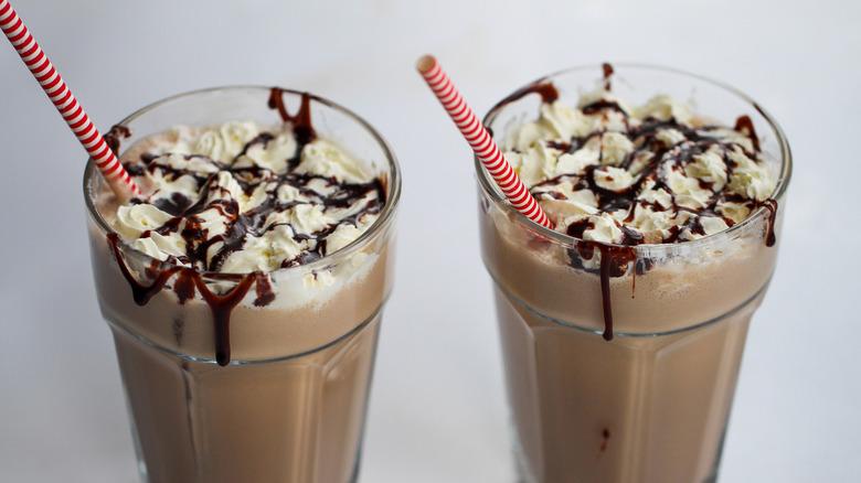 chocolate milkshakes in glasses with straws