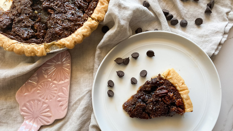 Chocolate pecan pie slice on a table