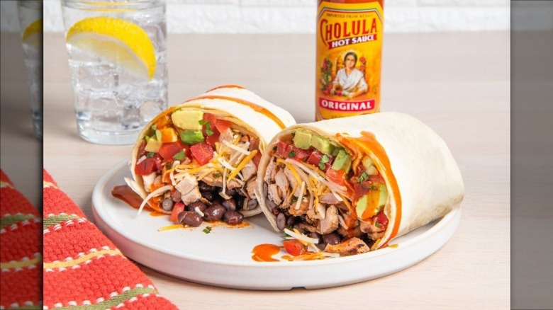 Burrito cross sectioned with cholula hot sauce