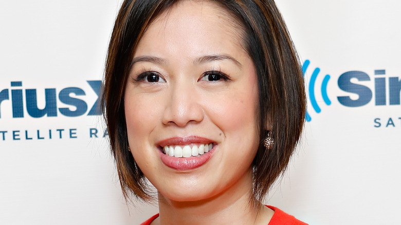 Christine Ha smiling in red sweater