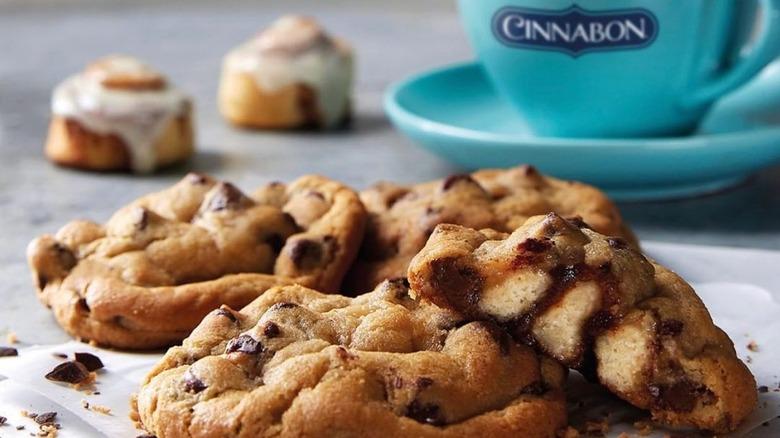 Cinnamon roll stuffed cookies next to blue mug