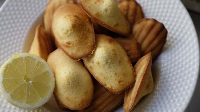Madeleines on plate with lemon