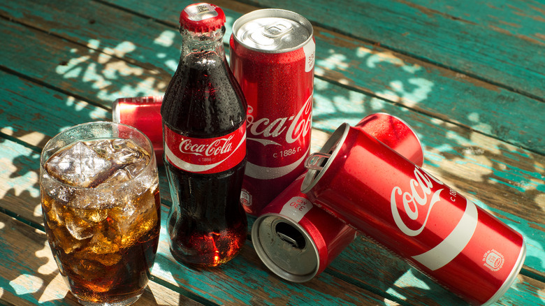 Coca-cola products on a picnic table