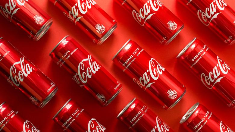 Coca-Cola bottles on red background