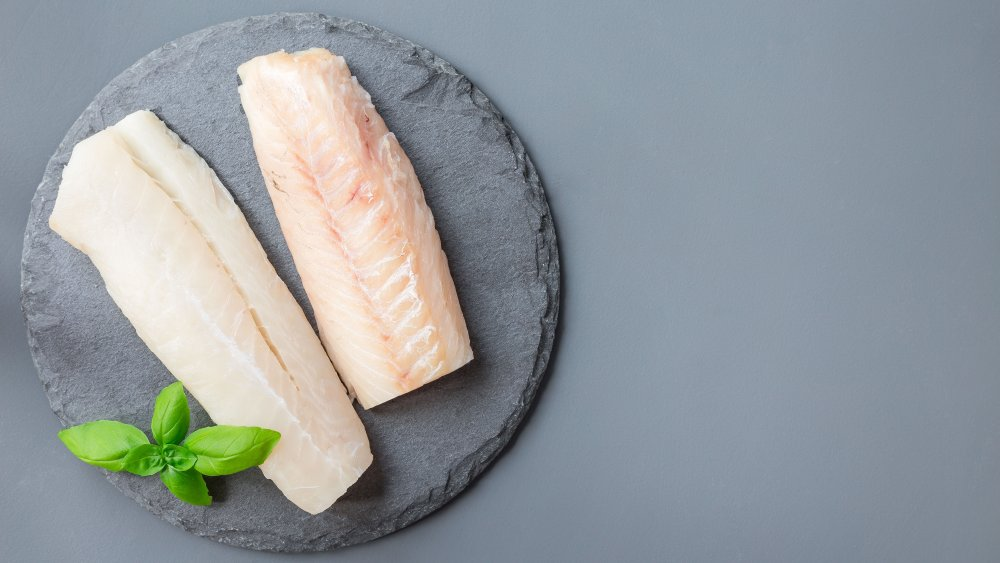 cod fillets against a stone background