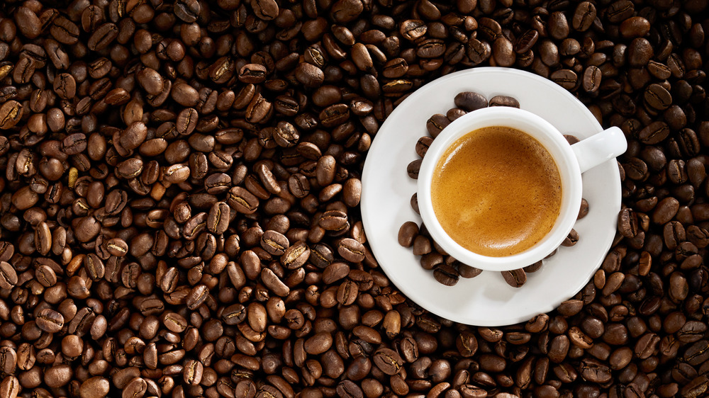 Coffee beans and an espresso