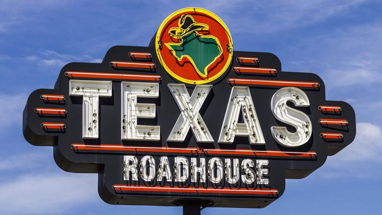 Texas Roadhouse sign blue sky