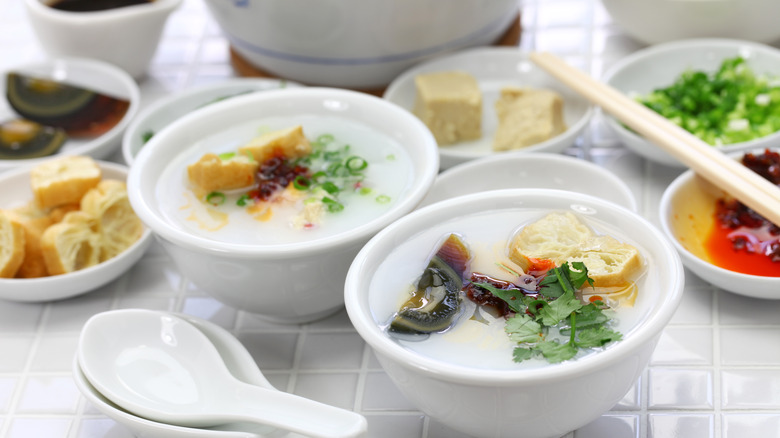 Bowls of congee with topping