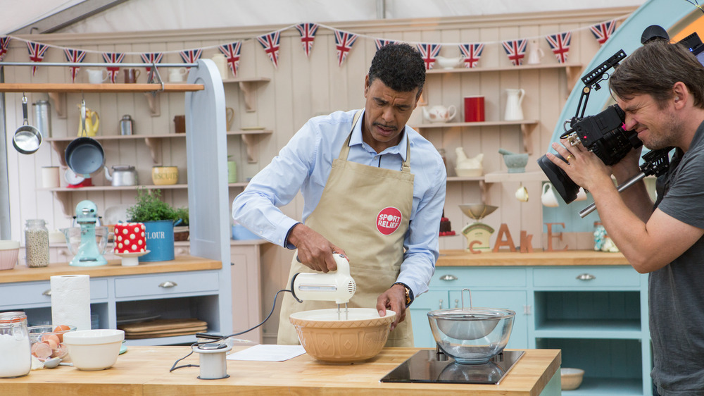 Cameraman films a man baking