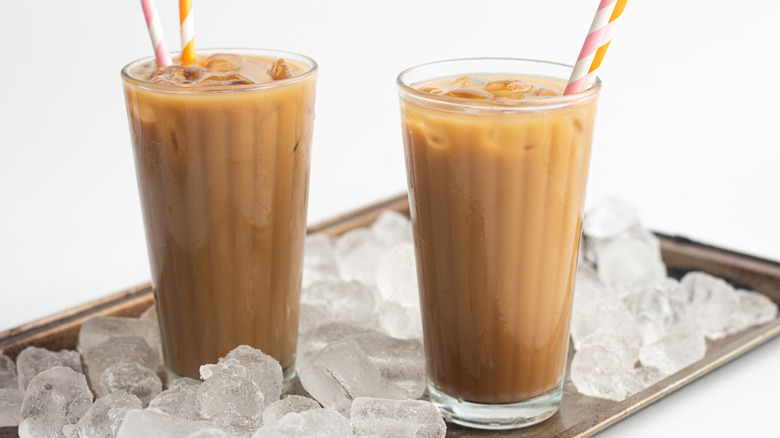 Iced coffee on tray with ice