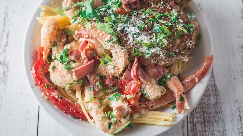 plate of chicken and shrimp carbonara
